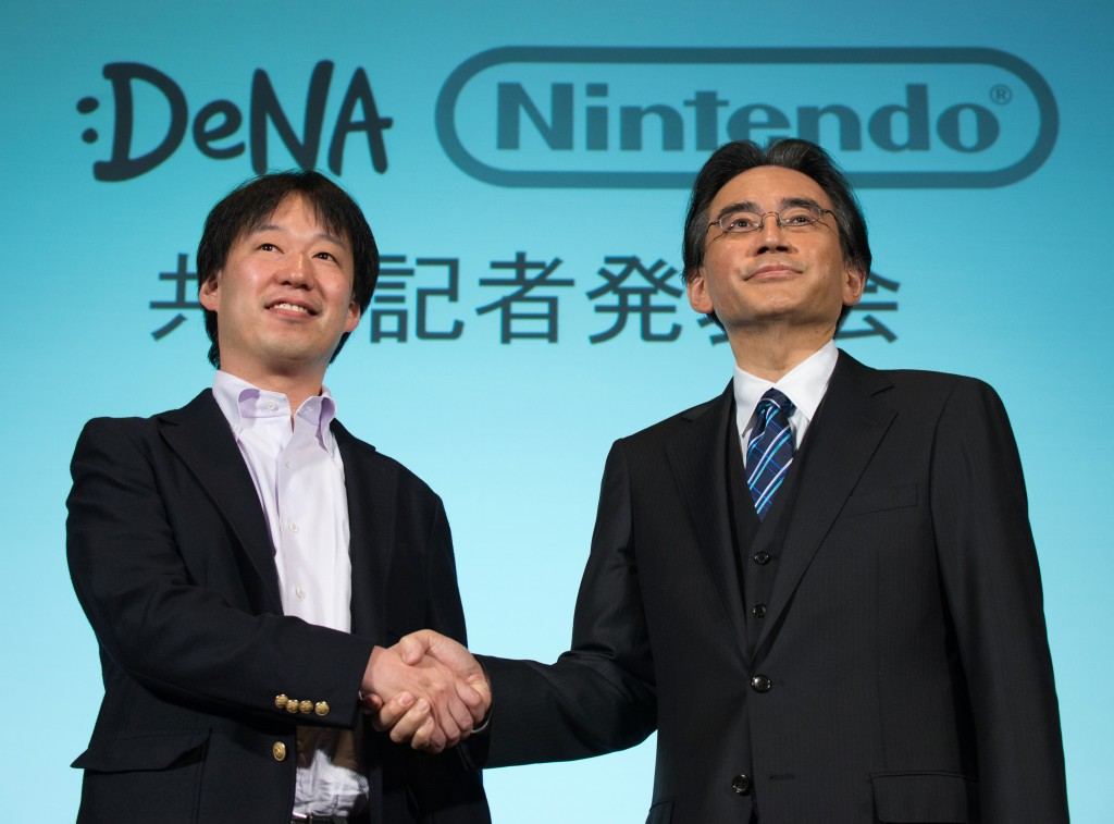 Nintendo President Satoru Iwata And DeNA President Isao Moriyasu Joint News Conference As The Companies Form Capital Alliance